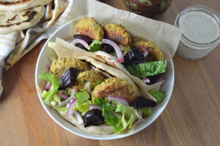 Vegan Falafel Pitas with Roasted Beets, Pickled Onions & Lemon-Tahini Sauce